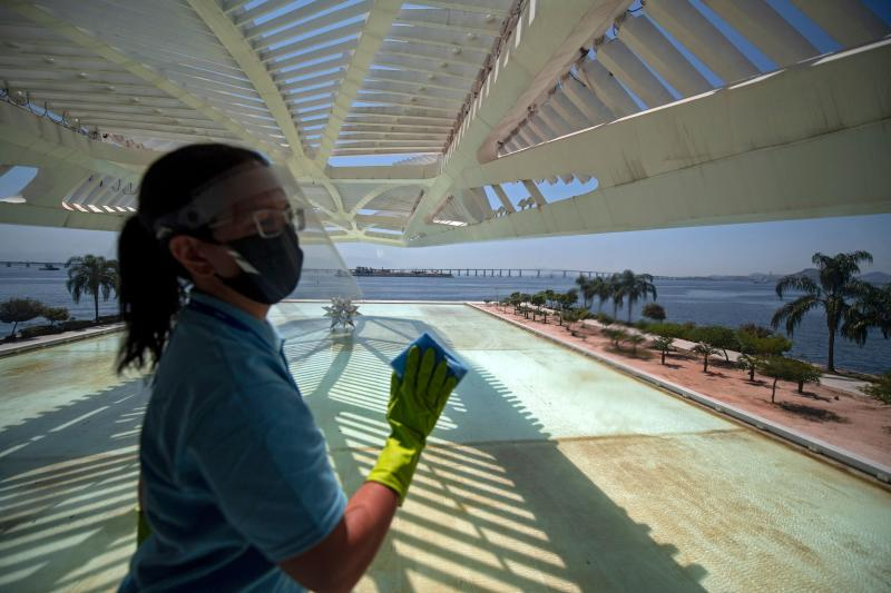 A worker disinfects an area of the Museum of Tomorrow prior to its reopening in Rio de Janeiro, Brazil on September 4, 2020, amid the COVID-19 novel coronavirus pandemic. - India, the United States and Brazil remain the three countries recording the greatest number of new cases over the past seven days, with 77,596, 40,875 and 40,035 cases respectively per day on average, according to an AFP count on Friday at 1100GMT. (Photo by MAURO PIMENTEL / AFP) (Photo by MAURO PIMENTEL/AFP via Getty Images)