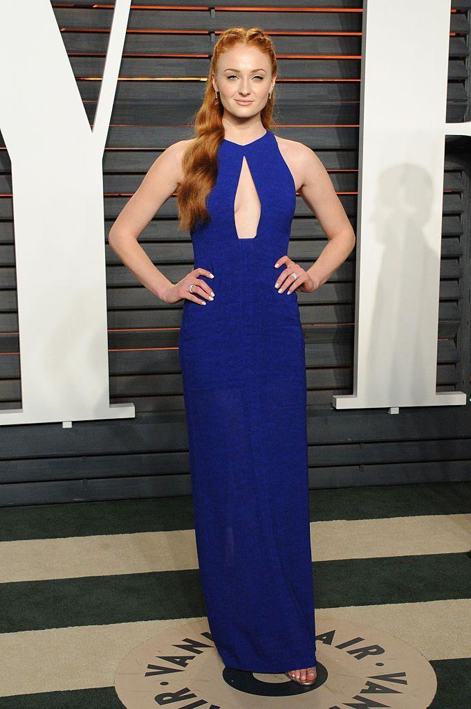 <p>The actor wore a royal blue Galvan dress with a cutout for the Vanity Fair Oscars party.</p>