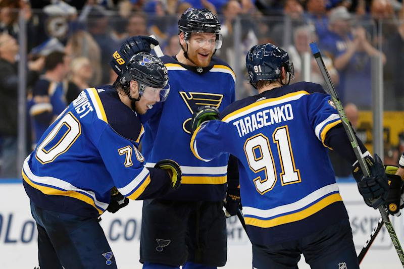 St. Louis Blues center Oskar Sundqvist (70), of Sweden; defenseman Colton Parayko (55); and Vladimir Tarasenko (91), of Russia, celebrate after the Blues scored a goal against the San Jose Sharks during the third period in Game 6 of the NHL hockey Stanley Cup Western Conference final series Tuesday, May 21, 2019, in St. Louis. The Blues won 5-1 to win the series 4-2. (AP Photo/Jeff Roberson)