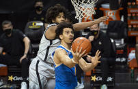 UCLA guard Jules Bernard (1) drives past Oregon guard LJ Figueroa (12) during the first half of an NCAA college basketball game Wednesday, March 3, 2021, in Eugene, Ore. (AP Photo/Andy Nelson)