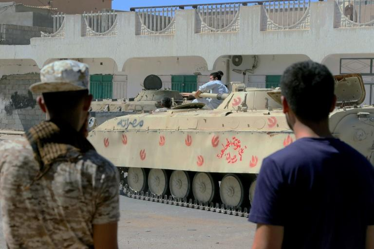 Forces loyal to Libya's UN-backed government gather next to tanks on August 27, 2016 in Sirte during a military operation to clear the Islamic State group from the city