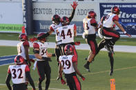 San Diego State players celebrate an interception late into the second half of an NCAA college football game against Nevada, Saturday, Nov. 21, 2020, in Reno, Nev. (AP Photo/Lance Iversen)