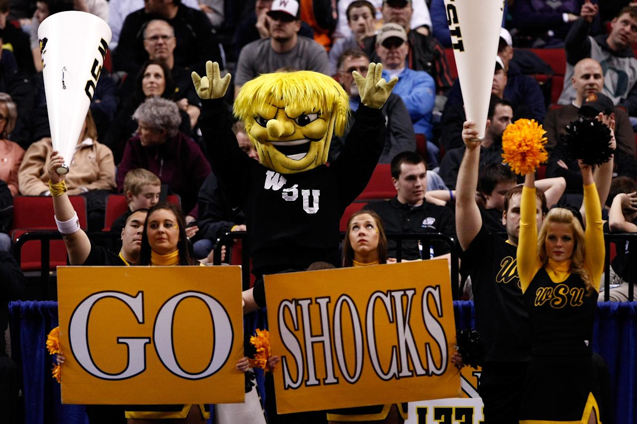 PORTLAND, OR - MARCH 15:  The Wichita State Shockers mascot and cheerleaders perform as the Shockers take on the Virginia Commonwealth Rams in the second round of the 2012 NCAA men's basketball tournament at Rose Garden Arena on March 15, 2012 in Portland, Oregon.  (Photo by Jonathan Ferrey/Getty Images)