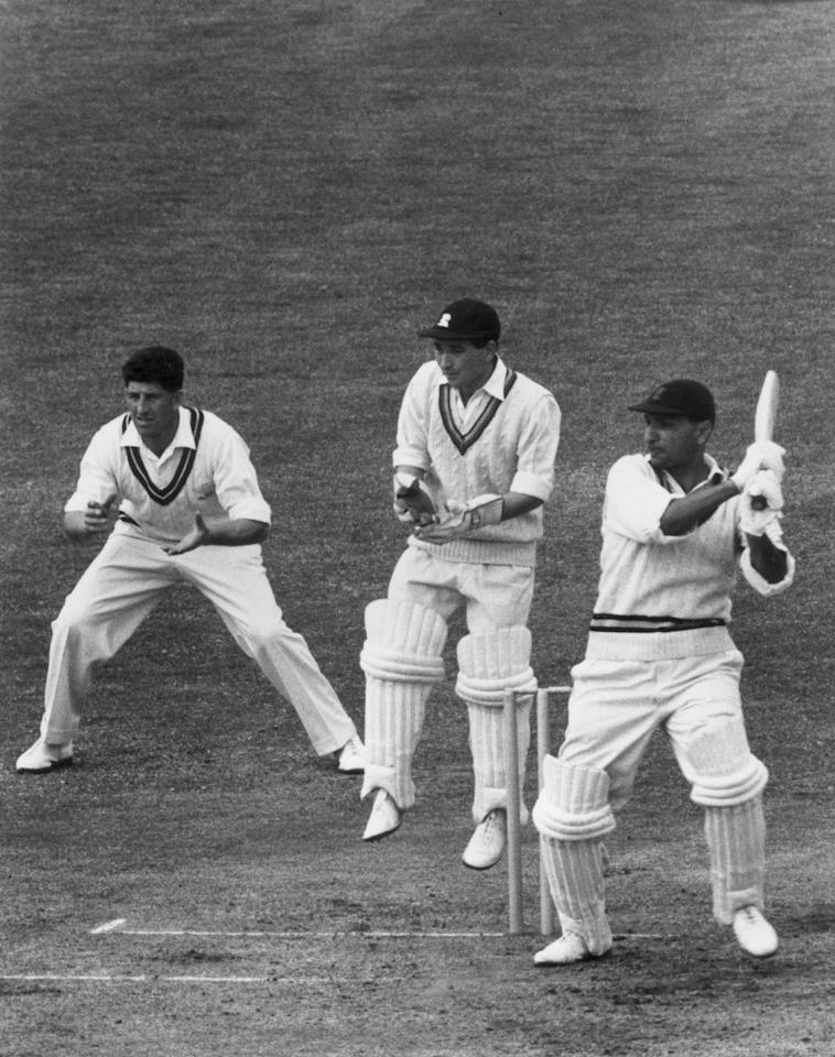 May 1959:  Indian cricketer Polly Umrigar (Pahlan Ratanji Umrigar) batting against Surrey at the Oval. The Surrey cricketers are Roy Swetman and Ken Barrington (1930 - 1981).  (Photo by Central Press/Getty Images)