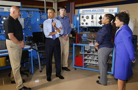 U.S. President Barack Obama tours the Community College of Allegheny West Hills Center with students in the Mechatronics program in Oakdale, Pennsylvania