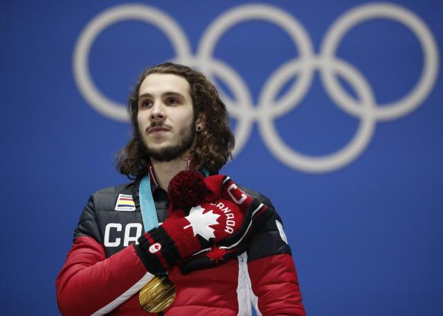 Medals Ceremony - Short Track Speed Skating Events - Pyeongchang 2018 Winter Olympics - Men's 1000m - Medals Plaza - Pyeongchang, South Korea - February 18, 2018 - Gold medalist Samuel Girard of Canada on the podium. REUTERS/Kim Hong-Ji