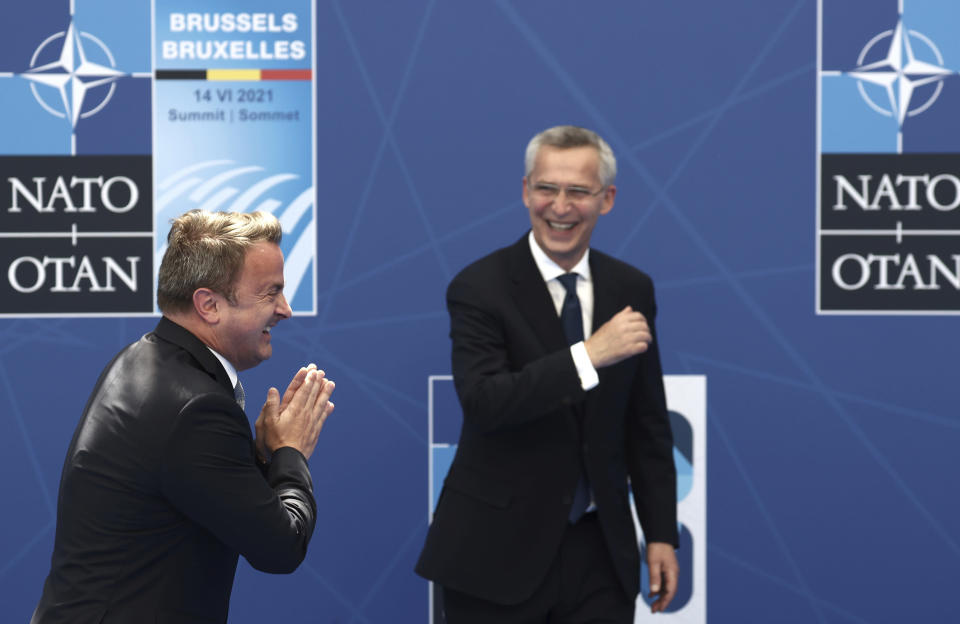 NATO Secretary General Jens Stoltenberg greets Luxembourg's Prime Minister Xavier Bettel during arrivals for a NATO summit at NATO headquarters in Brussels, Monday, June 14, 2021. U.S. President Joe Biden is taking part in his first NATO summit, where the 30-nation alliance hopes to reaffirm its unity and discuss increasingly tense relations with China and Russia, as the organization pulls its troops out after 18 years in Afghanistan. (Kenzo Tribouillard, Pool via AP)