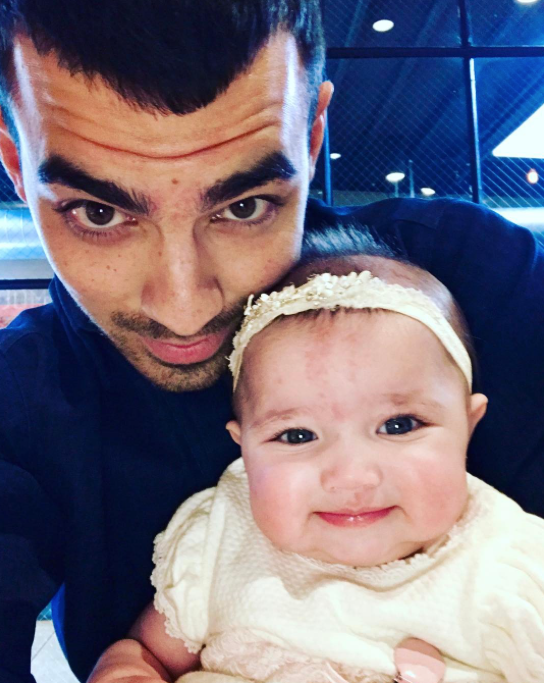 """<p>There's nothing like a doting uncle, and the singer clearly can't get enough of brother Kevin's baby girl, Valentina. """"My little niece Valentina,"""" he wrote as he showed her off on the same weekend that brother Nick became her godfather. (Photo: Courtesy <a href=""""https://www.instagram.com/p/BTzazlsA0sW/"""" rel=""""nofollow noopener"""" target=""""_blank"""" data-ylk=""""slk:Joe Jonas via Instagram"""" class=""""link rapid-noclick-resp"""">Joe Jonas via Instagram</a>) </p>"""