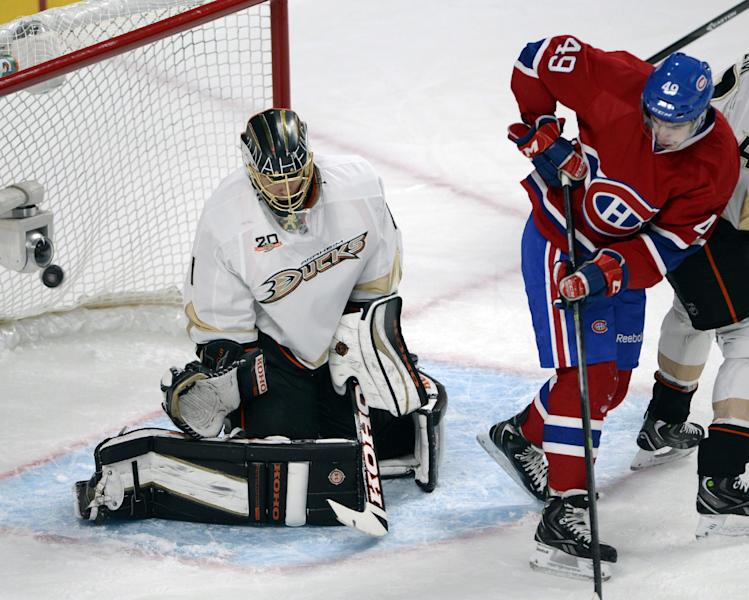 Montreal Canadiens left wing Michael Bournival (49) scores a goal on Anaheim Ducks goalie Jonas Hiller during the first period of an NHL hockey game Thursday, Oct. 24, 2013, in Montreal. (AP Photo/The Canadian Press, Ryan Remiorz)