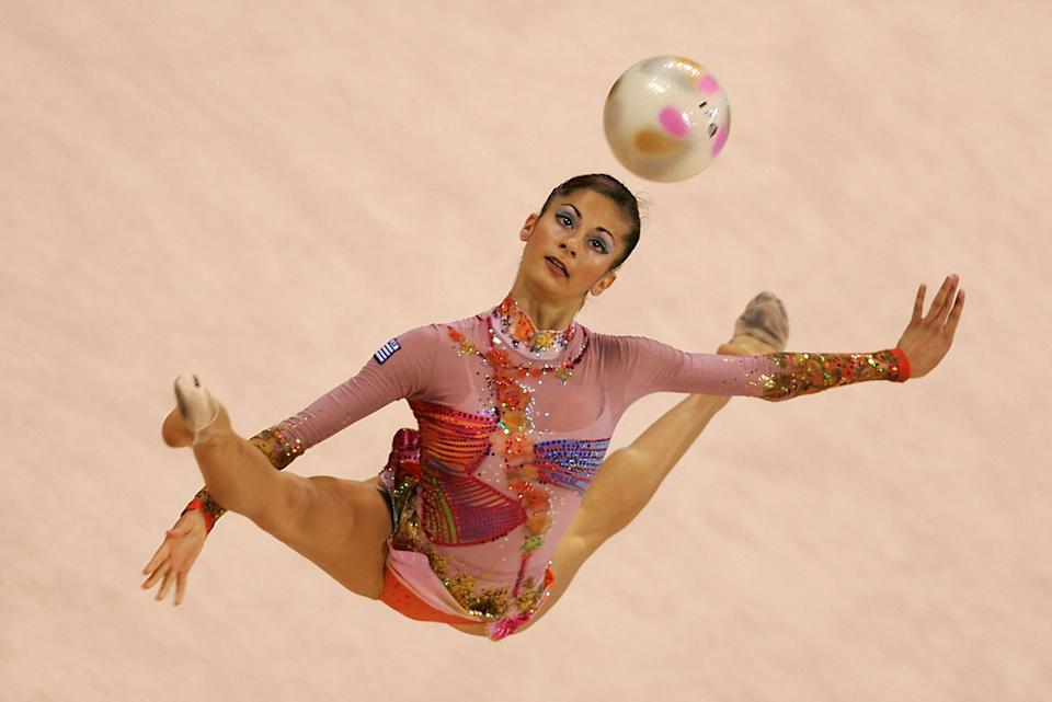 Eleni Andriola of Greece performs in the rhythmic gymnastics individual qualifications during the Athens 2004 Summer Olympic Games.