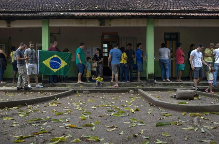 People in Rio de Janeiro queue to vote during the October 2018 general elections in Brazil, a country with a peculiar practice of allowing candidates to run under pseudonyms