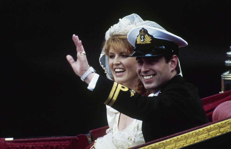 FILE - In this July 23, 1986, file photo, British Prince Andrew and his bride, Sarah, wave from their horse-drawn carriage as they leave Westminster Abbey following their marriage in London. They had two girls, Princess Beatrice and Princess Eugenie, but the marriage ended in divorce. (AP Photo/Dave Caulkin, File)