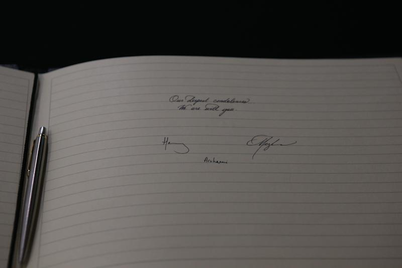 Harry and Meghan's signatures in the book of condolences. (Photo: WPA Pool via Getty Images)