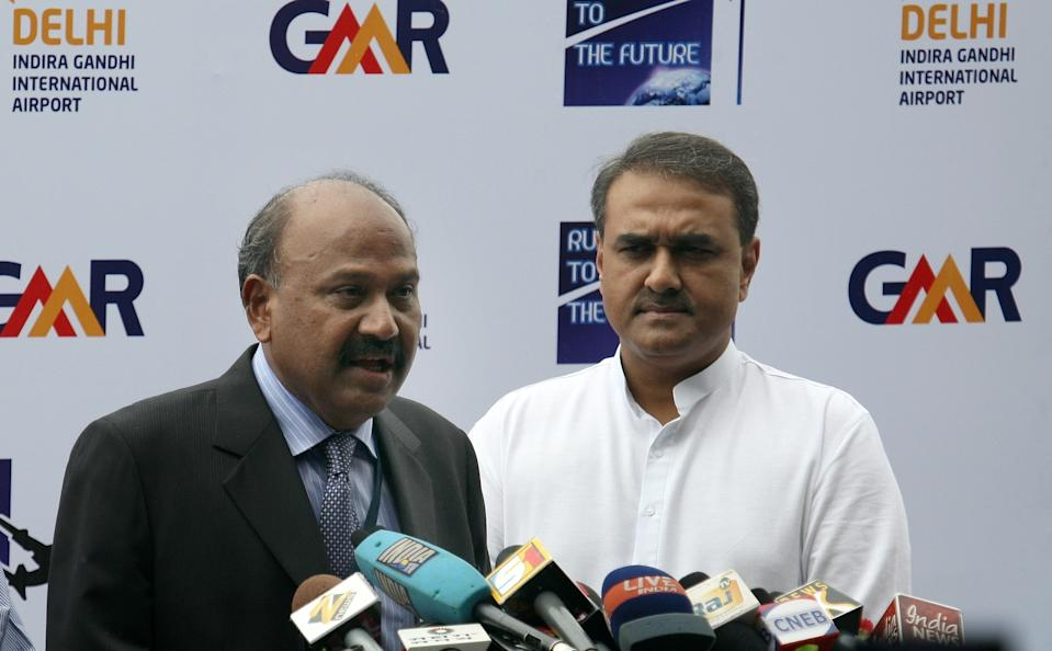 Group Chairman of GMR group G. M. Rao (L) addresses the media as Indian Aviation Minister Praful Patel (R) looks on during the inauguration of new runway '11-29' at Indira Gandhi International (IGI) Airport in New Delhi on August 21, 2008. Delhi International Airport (P) Limited (DIAL) inauguarated the 4430m long runway, the longest in the country which features CAT IIIB ILS at both ends. IGI airport becomes India's first airport with three runways. AFP PHOTO/Prakash SINGH