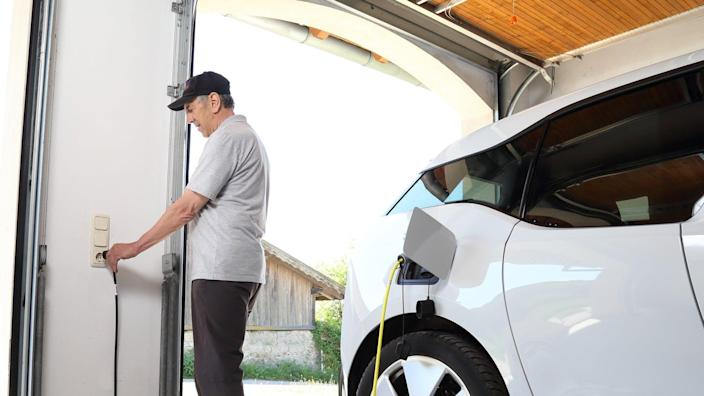"<span class=""caption"">Most garages can double as EV charging stations.</span> <span class=""attribution""><a class=""link rapid-noclick-resp"" href=""https://www.shutterstock.com/image-photo/man-charging-electric-car-outlet-home-1092177395"" rel=""nofollow noopener"" target=""_blank"" data-ylk=""slk:Shutterstock.com/riopatuca"">Shutterstock.com/riopatuca</a></span>"