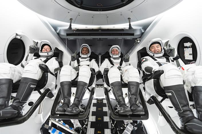 """NASA's Crew-1 crew members sit in SpaceX's Crew Dragon spacecraft during training. From left to right are NASA astronauts Shannon Walker, Victor Glover, and Mike Hopkins, as well as JAXA astronaut Soichi Noguchi. <p class=""""copyright"""">SpaceX via NASA</p>"""