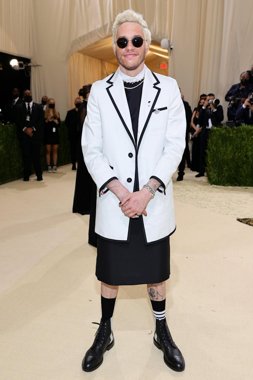 <p>Wearing Thom Browne with Silhouette sunglasses.</p>