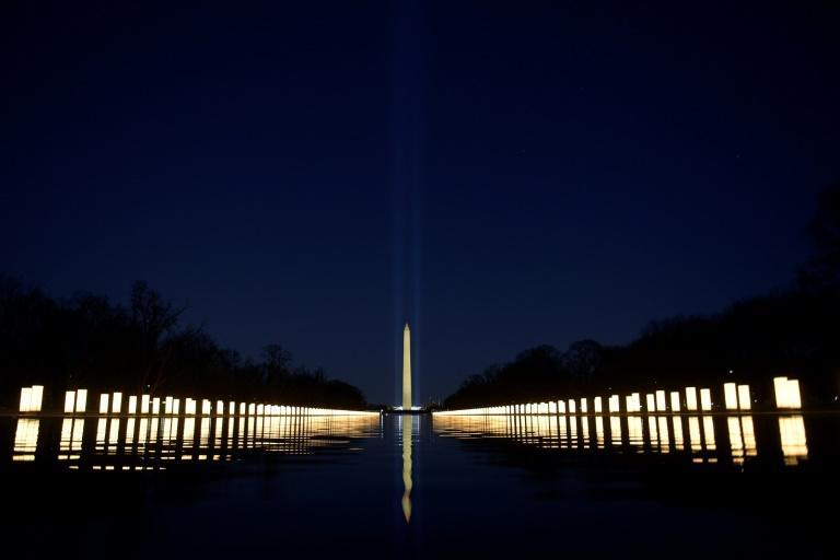 In Washington, the lights of the Reflecting Pool were turned on in tribute to American victims of the pandemic