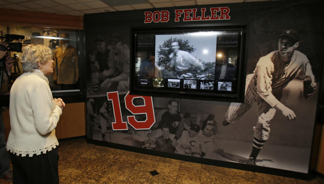 Anne Feller, widow of Bob Feller, watches a video featuring her husband Wednesday, May 13, 2015, in Cleveland. The exhibit features many items from Feller's playing and Navy careers from the former Bob Feller Museum in Van Meter, Iowa. (AP Photo/Tony Dejak)