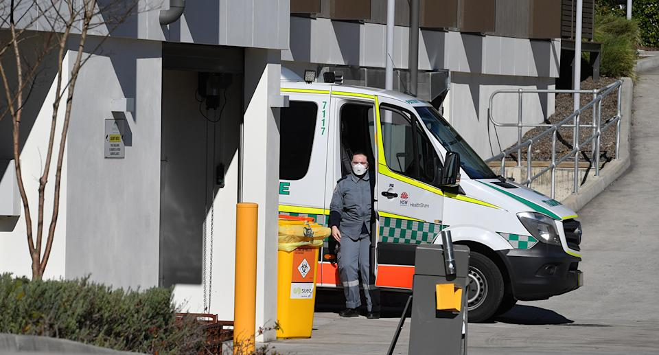 An ambulance is seen at the SummitCare aged care home at Baulkham Hills in Sydney on Monday. Source: AAP