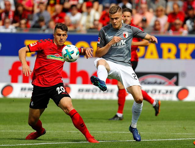 Soccer Football - Bundesliga - SC Freiburg v FC Augsburg - Schwarzwald-Stadion, Freiburg, Germany - May 12, 2018 SC Freiburg's Marc-Oliver Kempf in action with Augsburg's Alfred Finnbogason REUTERS/Kai Pfaffenbach DFL RULES TO LIMIT THE ONLINE USAGE DURING MATCH TIME TO 15 PICTURES PER GAME. IMAGE SEQUENCES TO SIMULATE VIDEO IS NOT ALLOWED AT ANY TIME. FOR FURTHER QUERIES PLEASE CONTACT DFL DIRECTLY AT + 49 69 650050