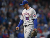 New York Mets' Walker Lockett walks back to the dugout after being taken out of the team's baseball game against the Chicago Cubs during the third inning Thursday, June 20, 2019, in Chicago. (AP Photo/Jim Young)