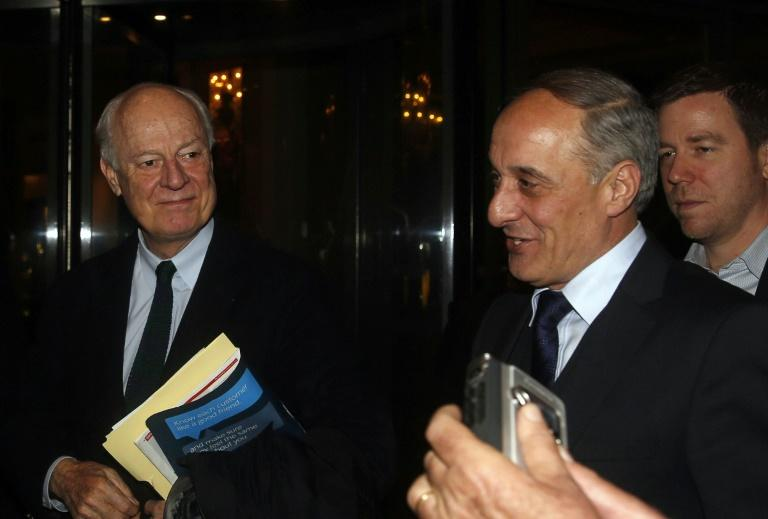 UN envoy for Syria, Staffan de Mistura (L), arrives at his hotel with Syrian assistant foreign minister, Ayman Sosan (R) in the Syrian capital Damascus on February 15, 2016