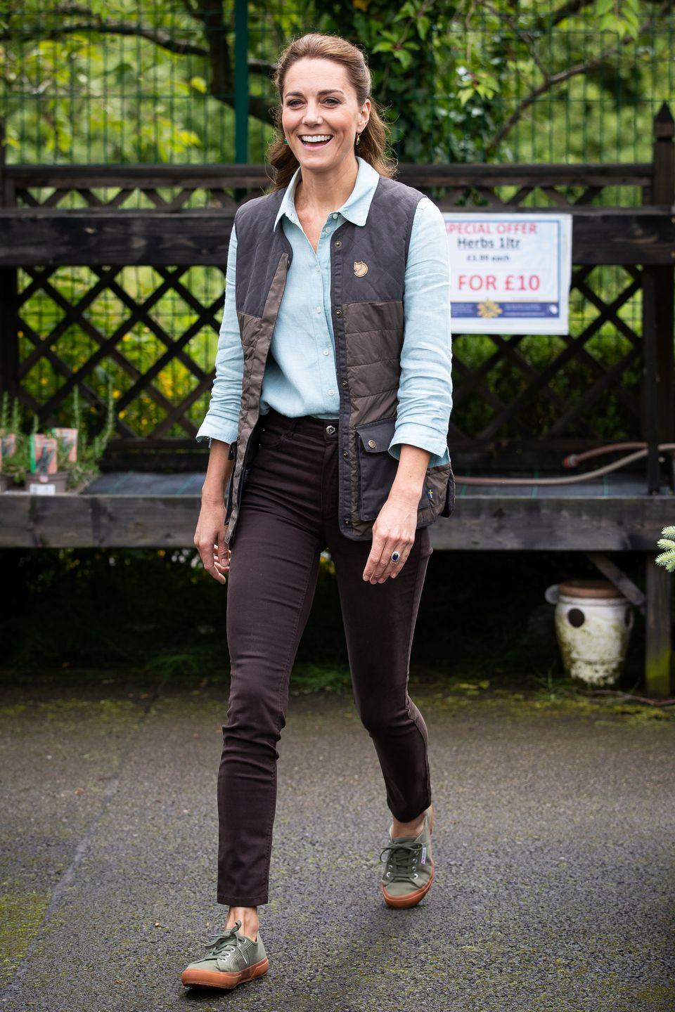 """<p>The Duchess chose a preppy yet functional look for a visit to Fakenham Garden Centre in Norfolk. Kate, a gardener herself, spoke with Fakenham's owners about their experience running the center during the COVID-19 pandemic. This outfit consisted of a light blue button down shirt, black skinny jeans, a Fjallraven vest, and green Superga sneakers. </p><p>Find a similar vest <a href=""""https://www.backcountry.com/fjallraven-greenland-down-liner-vest-womens"""" rel=""""nofollow noopener"""" target=""""_blank"""" data-ylk=""""slk:here"""" class=""""link rapid-noclick-resp"""">here</a>. </p><p><a class=""""link rapid-noclick-resp"""" href=""""https://go.redirectingat.com?id=74968X1596630&url=https%3A%2F%2Fwww.superga-usa.com%2F&sref=https%3A%2F%2Fwww.redbookmag.com%2Flife%2Fg34824194%2Fkate-middleton-fashion%2F"""" rel=""""nofollow noopener"""" target=""""_blank"""" data-ylk=""""slk:Shop Superga"""">Shop Superga</a></p>"""