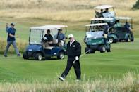 Trump, seen playing a round of golf at his Trump Turnberry luxury resort in July 2018, reputedly made Milne an offer of cash, jewellery and a golf club membership for his house, but was turned down