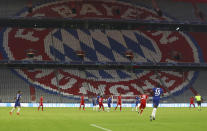 Players in action in front of the empty stands during the Champions League round of 16 second leg soccer match between Bayern Munich and Chelsea at Allianz Arena in Munich, Germany, Saturday, Aug. 8, 2020. (AP Photo/Matthias Schrader)