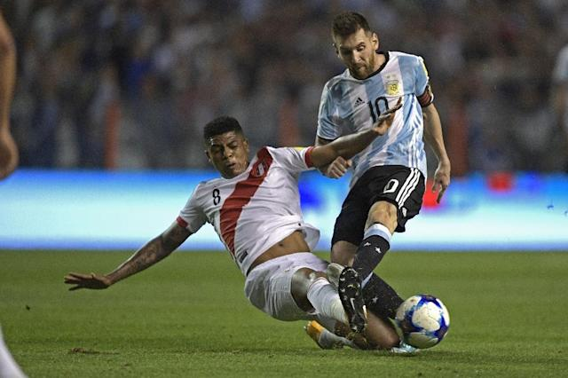 Argentina's Lionel Messi (R) is marked by Peru's Wilder Cartagena during their 2018 World Cup qualifier football match in Buenos Aires on October 5, 2017 (AFP Photo/Juan MABROMATA)
