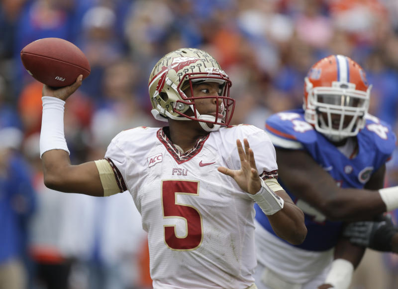 Florida State quarterback Jameis Winston (5) throws a pass as he is pressured by Florida defensive lineman Leon Orr (44) during the first half of an NCAA college football game in Gainesville, Fla., Saturday, Nov. 30, 2013.(AP Photo/John Raoux)