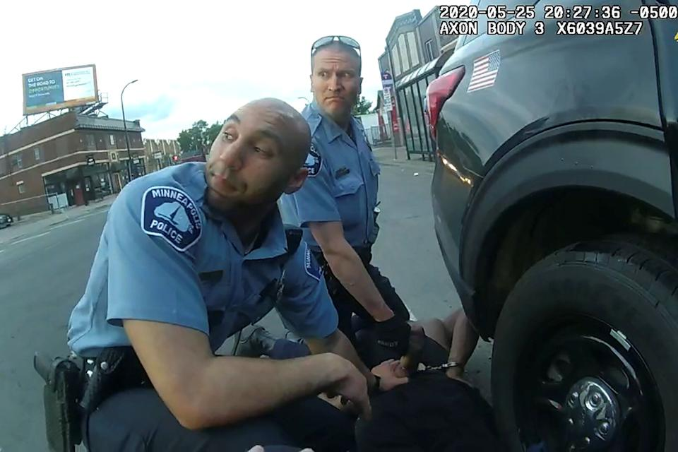 Video taken from an officer's body camera video shows George Floyd being kneeled upon by Chauvin, who's next to Kueng. (Photo: Handout . / Reuters)