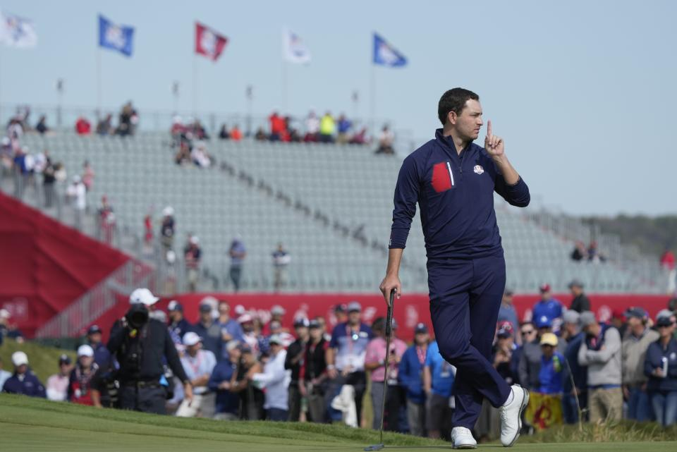 Team USA's Patrick Cantlay hushes the crowd on the 15th hole during a foursome match the Ryder Cup at the Whistling Straits Golf Course Friday, Sept. 24, 2021, in Sheboygan, Wis. (AP Photo/Charlie Neibergall)