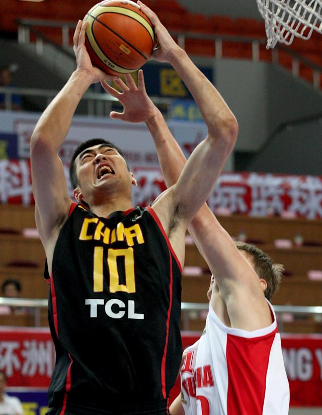 China's Zhang Zhaoxu (L) in action against Russia during their FIBA Stankovic Continental Cup basketball match in Haining, east China's Zhejiang province on August 4, 2011. Russia beat China 50-49. AFP PHOTO (Photo credit should read STR/AFP/Getty Images)
