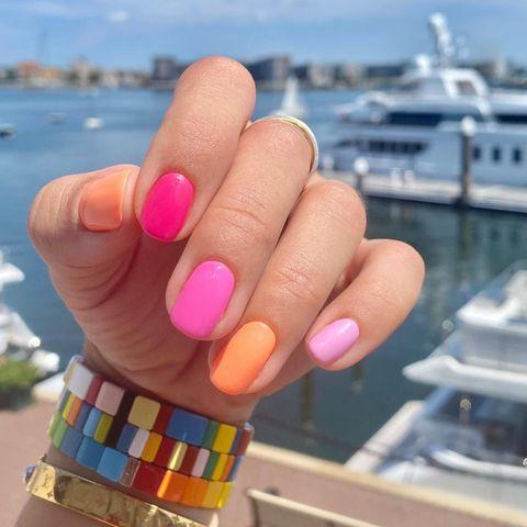 "<p>This look right here is what you get when a handful of colors turns into a hand full of color. <strong>Alternate different shades</strong> in the same color family or throw in a few other <a href=""https://www.cosmopolitan.com/style-beauty/beauty/news/g4598/nail-polish-colors-for-spring/"" rel=""nofollow noopener"" target=""_blank"" data-ylk=""slk:spring nail polishes"" class=""link rapid-noclick-resp"">spring nail polishes</a> to make a custom color combination, like this pink and orange pairing, for a super-easy nail art look.</p><p><a href=""https://www.instagram.com/p/CEt0BDol8kz/?utm_source=ig_embed&utm_campaign=loading"" rel=""nofollow noopener"" target=""_blank"" data-ylk=""slk:See the original post on Instagram"" class=""link rapid-noclick-resp"">See the original post on Instagram</a></p>"