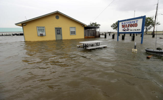 <p>The Bayfront Seafood restaurant is surrounded by floodwaters in the aftermath of Hurricane Harvey Saturday, Aug. 26, 2017, in Palacios, Texas. (Photo: David J. Phillip/AP) </p>