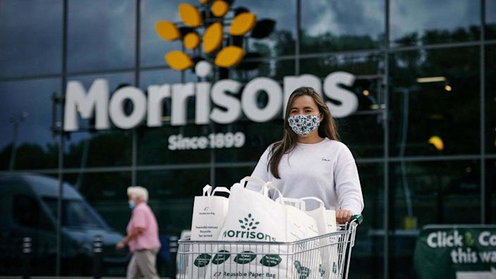 A woman with a supermarket trolley outside Morrisons