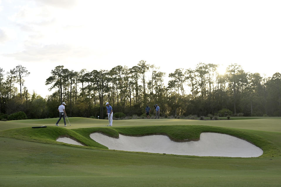 Collin Morikawa, left, and Billy Horschel check the 18th green before putting during the third round of the Workday Championship golf tournament, Feb. 27, 2021, in Bradenton, Fla. (AP Photo/Phelan M. Ebenhack)