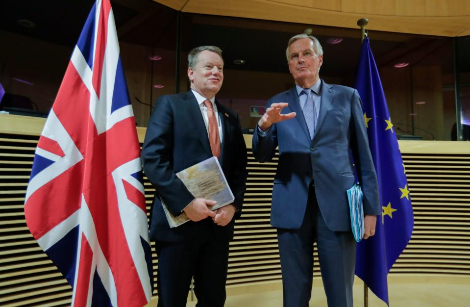 European Union chief Brexit negotiator Michel Barnier (R) and the British Prime Minister's Europe adviser David Frost speak at start of the first round of post-Brexit trade deal talks between the EU and the United Kingdom, in Brussels on March 2, 2020. (Photo by Olivier HOSLET / POOL / AFP) (Photo by OLIVIER HOSLET/POOL/AFP via Getty Images)