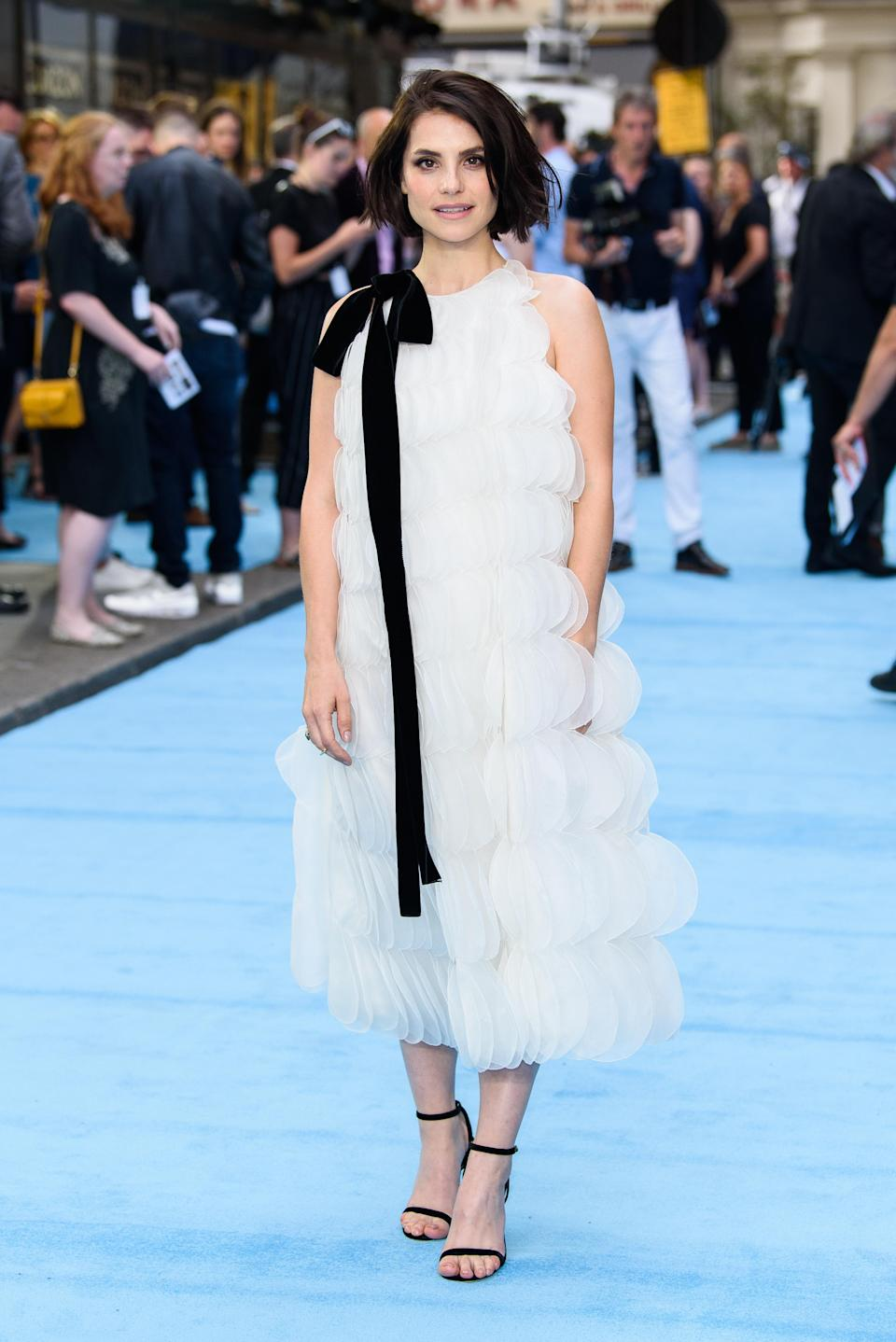 <p>For the 4 July London premiere of 'Swimming with Men', actress Charlotte Riley donned a frothy Oscar de la Renta dress with nineties-inspired heels. <em>[Photo: Getty]</em> </p>