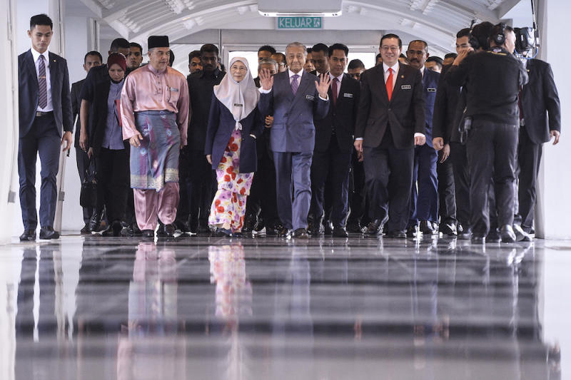 Prime Minster Tun Dr Mahathir Mohamad, Deputy Prime Minister Datuk Seri Dr Wan Azizah Wan Ismail and Finance Minister Lim Guan Eng arrive in Parliament for the tabling of Budget 2020 on October 11, 2019. — Picture by Miera Zulyana