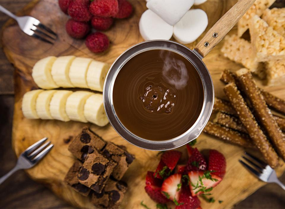chocolate fondue with sliced strawberries and bananas