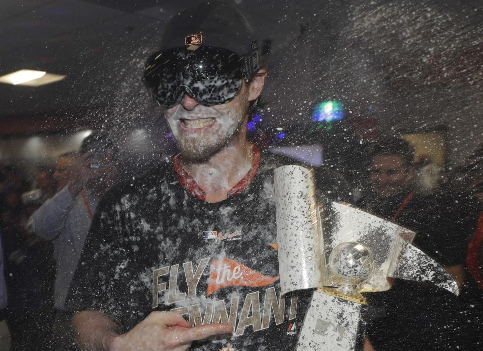 Josh Reddick, seen here being drenched in beer and champagne, is happy that the Astros are in the World Series, and he's also happy that they're playing the Dodgers. (AP Photo)