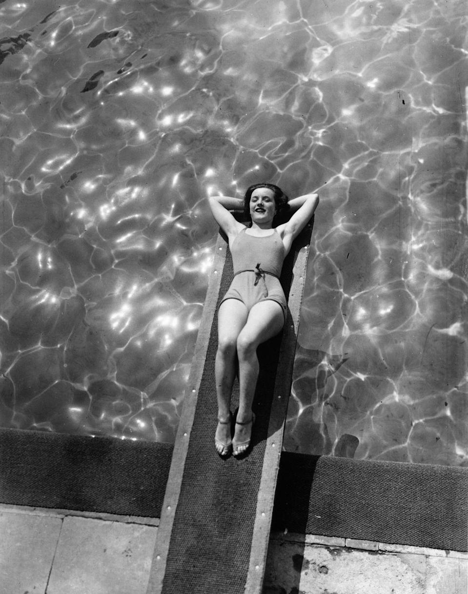 <p>Diving boards aren't just for diving. As this woman shows us, they make the perfect chaise lounge. </p>