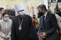 U.S. Secretary of State Antony Blinken, right, accompanied by the Head of the Independent Ukrainian Church Metropolitan Epiphanius, second left, visits the Mikhailovsky Zlatoverkhy Cathedral (St. Michael's Golden-Domed Cathedral) in Kyiv, Ukraine, Thursday, May 6, 2021. (AP Photo/Efrem Lukatsky, Pool)