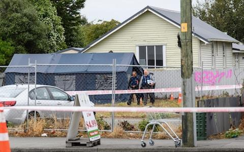 Police officers are seen at Linwood mosque on Sunday in Christchurch, New Zealand - Credit: Getty