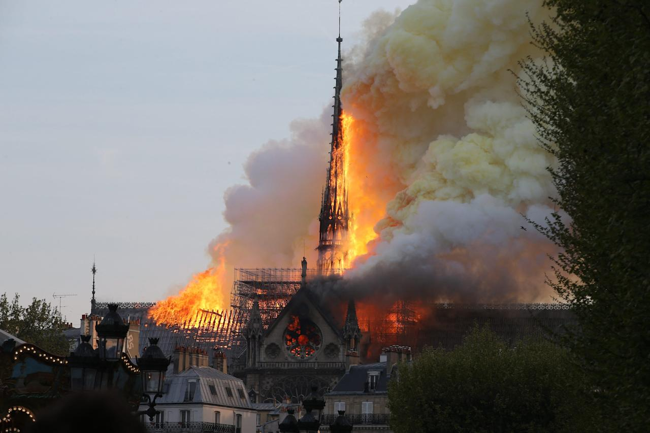 <p>Smoke and flames rise during a fire at the landmark Notre Dame Cathedral in central Paris on April 15, 2019, potentially involving renovation works being carried out at the site, the fire service said. Photo by ABACAPRESS.COM </p>