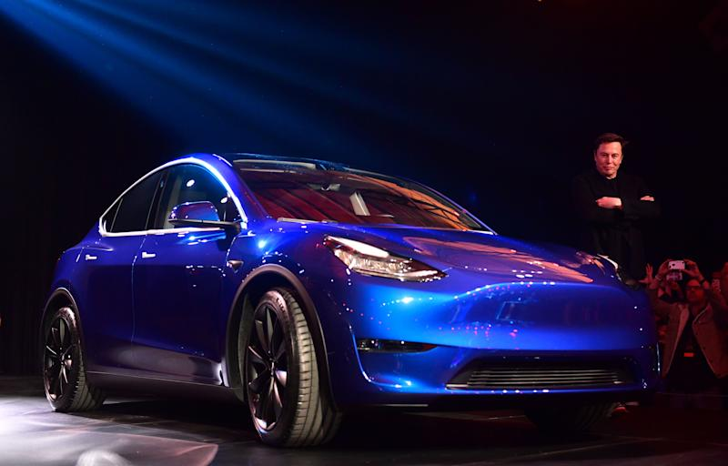 Tesla CEO Elon Musk views the new Tesla Model Y at its unveiling in Hawthorne, California on March 14, 2019. (Photo by Frederic J. BROWN / AFP) (Photo credit should read FREDERIC J. BROWN/AFP/Getty Images)