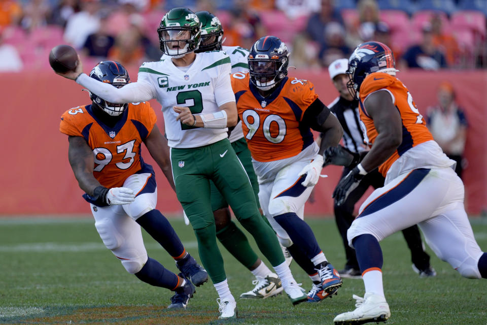 New York Jets quarterback Zach Wilson (2) throws under pressure against the Denver Broncos during the second half of an NFL football game, Sunday, Sept. 26, 2021, in Denver. The Broncos won 26-0. (AP Photo/David Zalubowski)